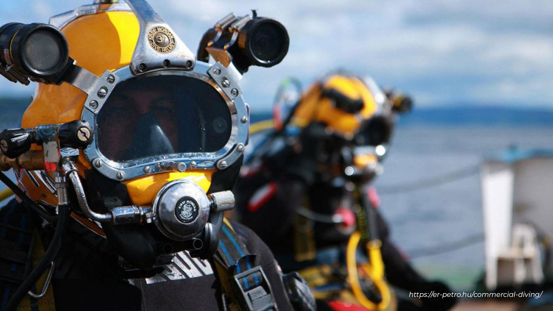 Two divers wearing headgear