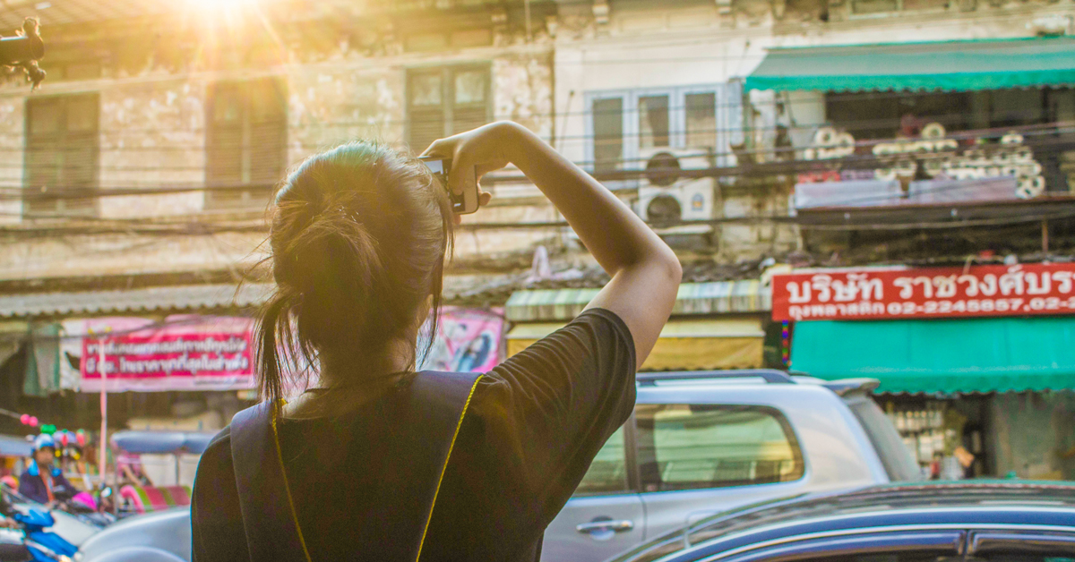 Girl taking a photo in Bangkok, Thailand