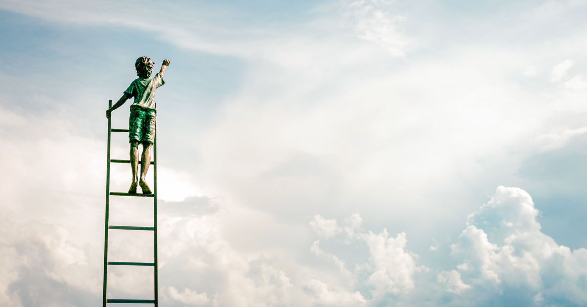 boy climbing a ladder reaching for the sky