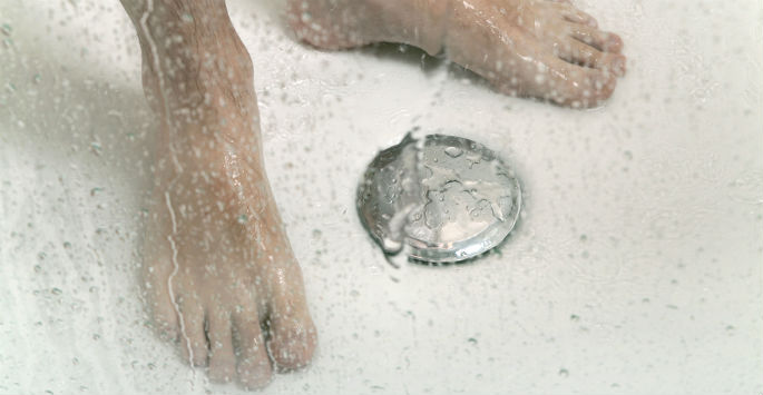 close up of feet being soaked in water