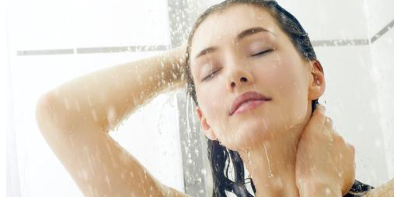 close up of girl taking shower
