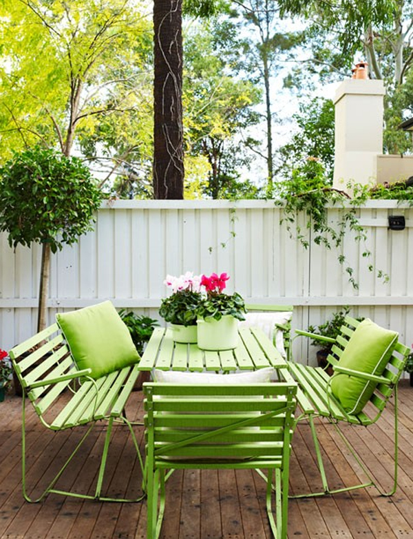 green benches in backyard
