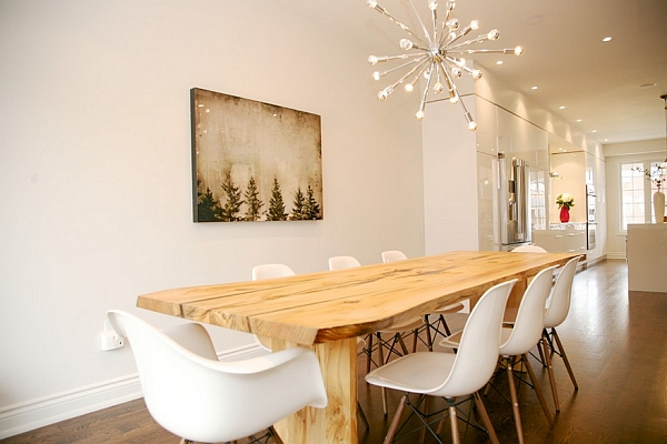 modern dining room with statement light fixture