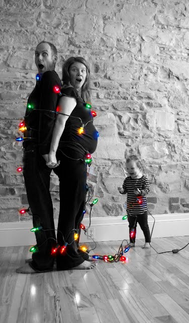 toddler catches parents in Christmas light ropes