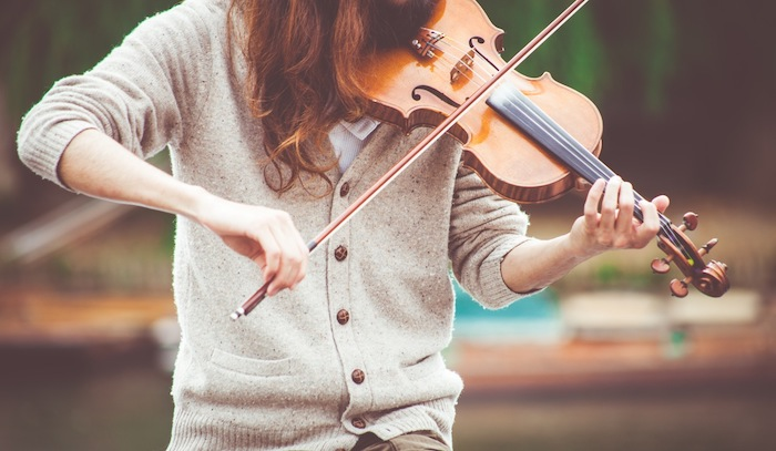 Woman in Gray Cardigan Playing a Violin