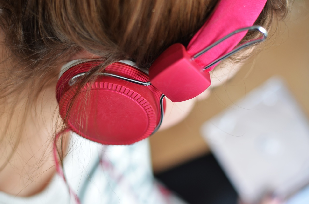 woman with pink headphones