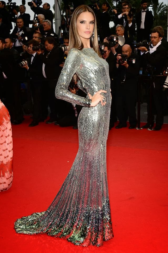 woman poses on red carpet