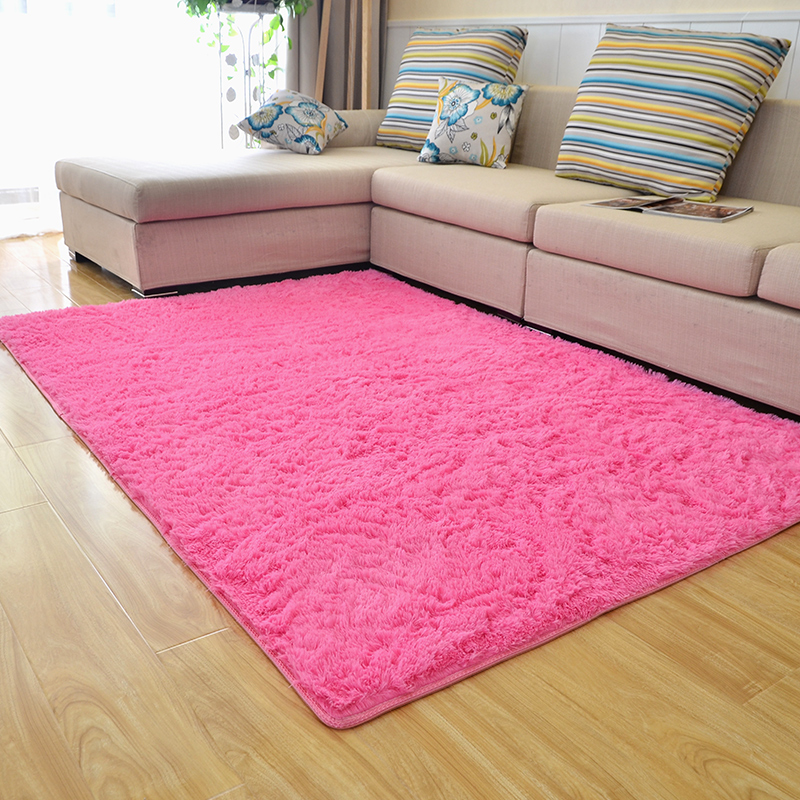 living room with pink carpet