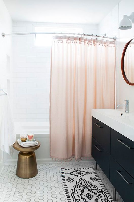 bathroom with pink shower curtain