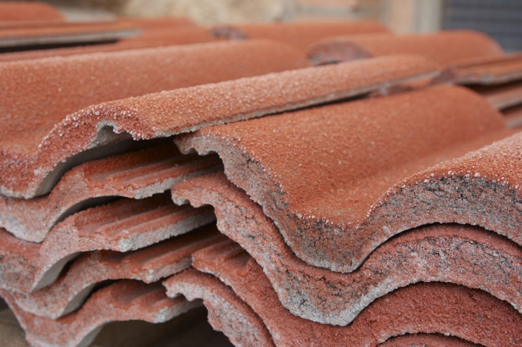 Clay and concrete roofing tiles