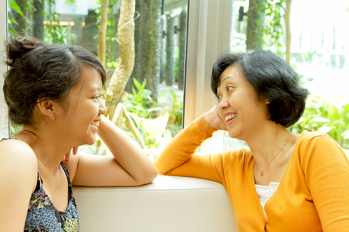 asian mother and daughter talking happy smiling