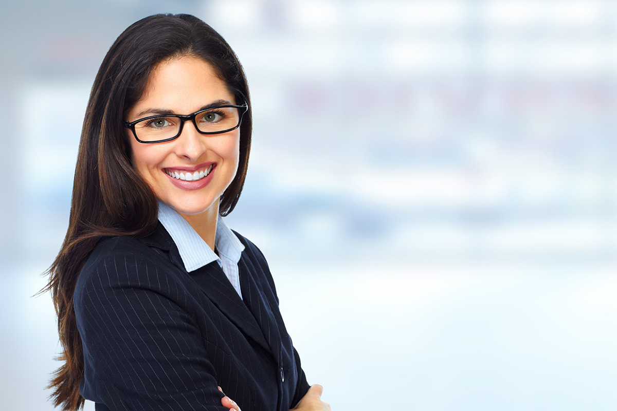 business woman smiling into camera