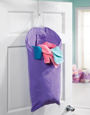 purple laundry bag behind door