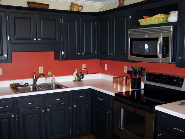 red-wall-black-cabinet