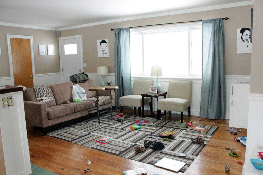 messy living room with children's toys