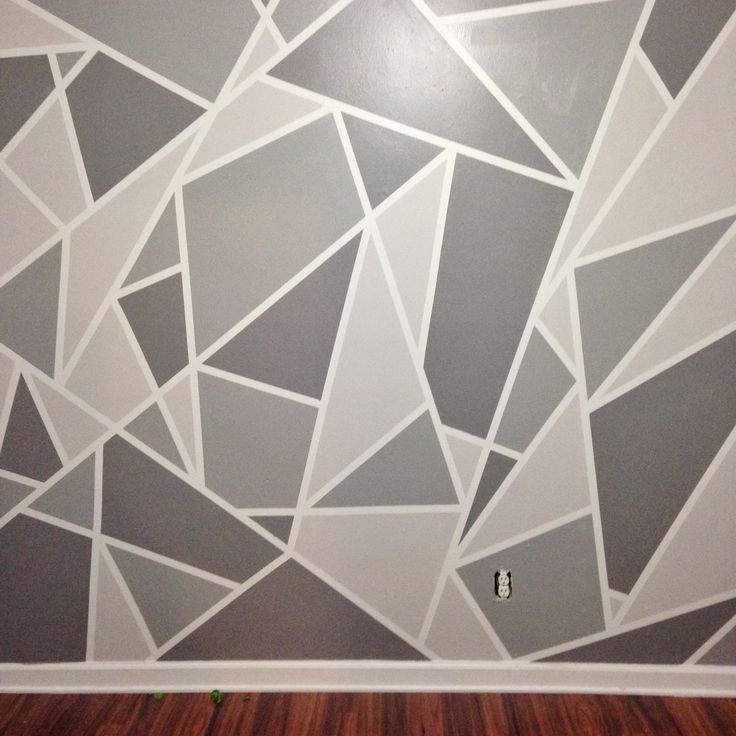 wall painted with brown and grey triangles