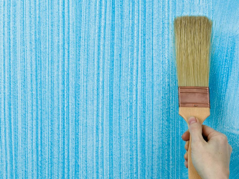 brushing blue wall