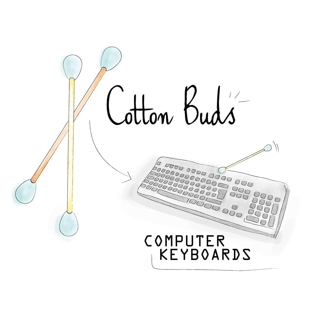 clean keyboard with cotton bud