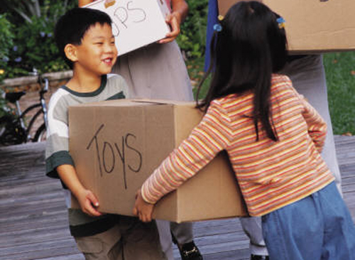 Asian children carrying box