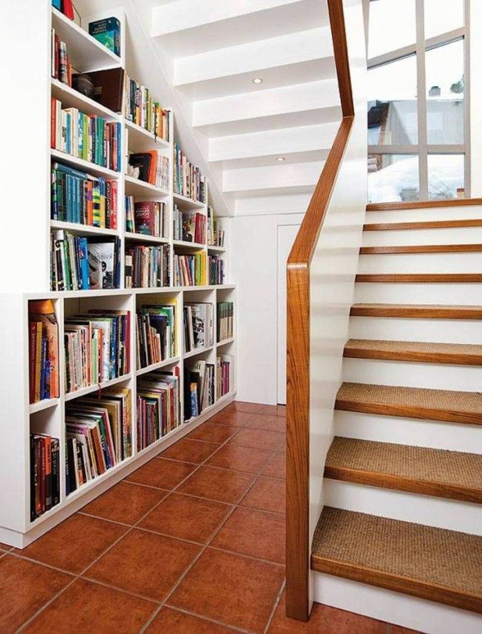 book shelf under stairs