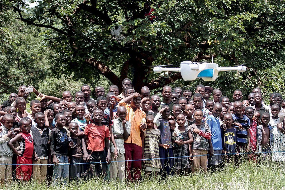 On 12 March 2016, children in Malawi look on amazed in the community demonstration of Unmanned Aerial Vehicles (UAVs or drones) flying in Lilongwe. The Ministry of Health and UNICEF launched the first 10km auto programmed flight in a trial to speed up the testing and diagnosis of HIV in infants. Malawi has a national HIV prevalence rate of 10% - still one of the highest in the world. An estimated 1 million Malawians were living with HIV in 2013 and 48,000 died from HIV-related illnesses in the same year. Whilst progress has been made, and today 90% of pregnant women know their HIV status, there is still a drop off with testing and treating babies and children. In 2014, around 10,000 children in Malawi died from HIV-related diseases and less than half of all children were on treatment. Samples are currently transported by road, either by motorbike or local authority ambulances. Various factors including the high cost of diesel fuel, poor state of roads and limited distribution schedules have resulted in extreme delays in lab sample transport, constituting a significant impediment for the scaling up of paediatric ARTís effectiveness. In March 2016, the Government of Malawi and UNICEF have started testing the use of Unmanned Aerial Vehicles (UAVs or drones) to explore cost effective ways of reducing waiting times for HIV testing of infants. The test, which is using simulated samples, will have the potential to cut waiting times dramatically, and if successful will be integrated into the health system alongside others mechanisms such as road transport and SMS. The first successful test flight completed the 10km route unhindered travelling from a community health centre to the Kamuzu Central Hospital laboratory. Local residents gathered in amazement as the vehicle took off and flew away in the direction of the hospital. The test flights which are assessing viability including cost and safety, will continue until Friday 18th March. The UAV flights are suppo