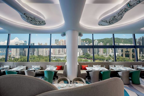 The interior of the open-air bar restaurant SKYE Roofbar and Dining has a panoramic view of the sky from the window.