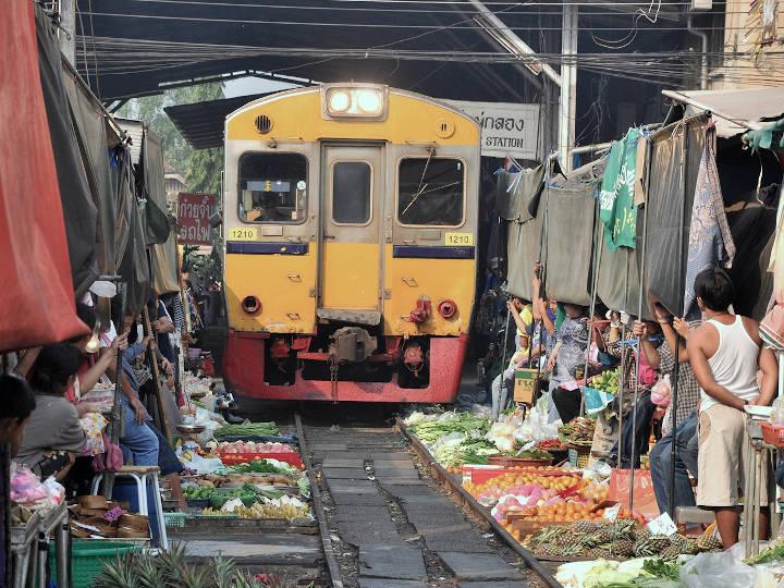 The market giving its way to the train @Train Umbrella Market