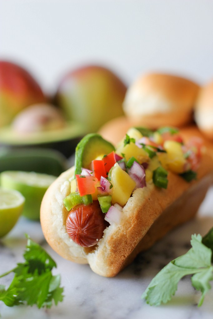 damndelicious http://damndelicious.net/2013/06/06/hawaiian-hot-dogs-with-mango-salsa/