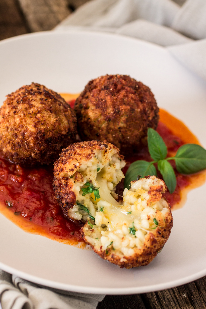 oliviascuisine http://www.oliviascuisine.com/arancini-di-riso-with-balsamic-vinegar-and-caramelized-onions-marinara-sauce/
