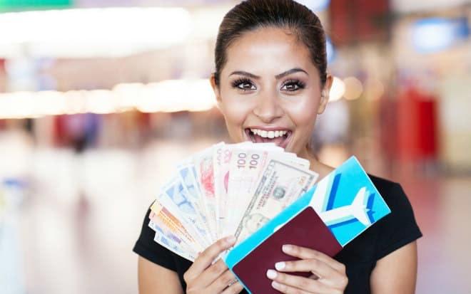 girl-holding-international-money-travel-passport_content