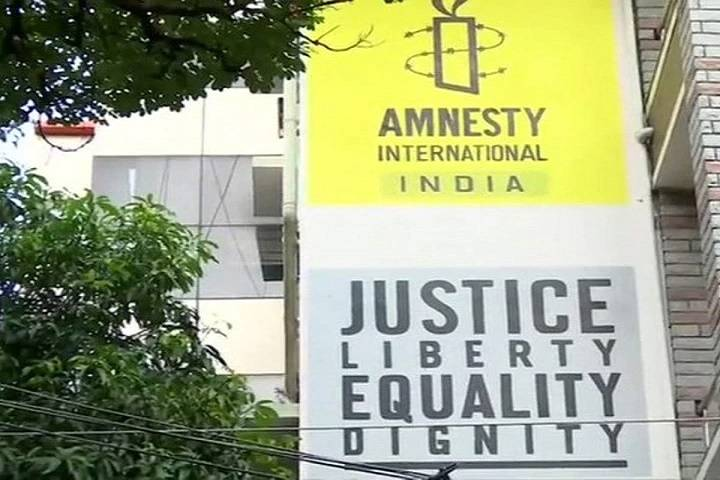 amnesty international halts india