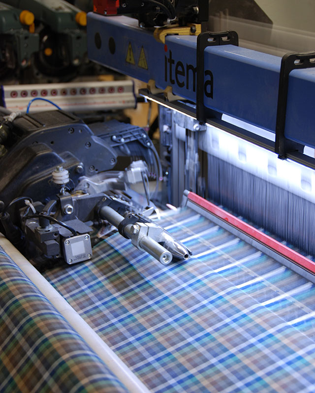 Fabric undergoing the application of anti-viral properties at Albini Group's manufacturing headquarters.