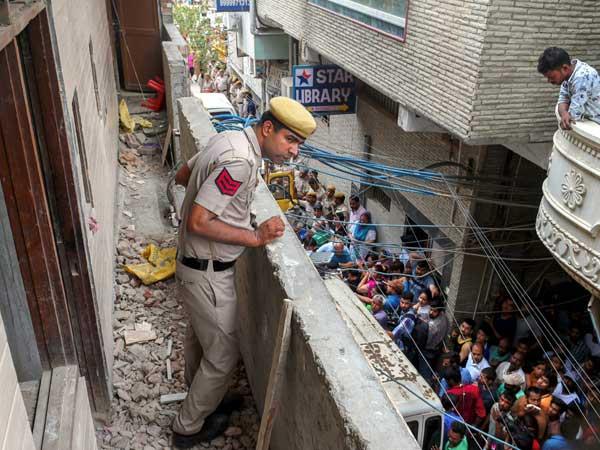11 of a family found dead in Delhi home