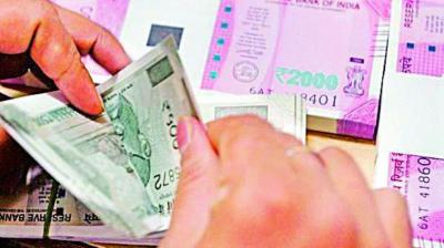 A weak dollar against major currencies overseas restricted the rupee's fall.