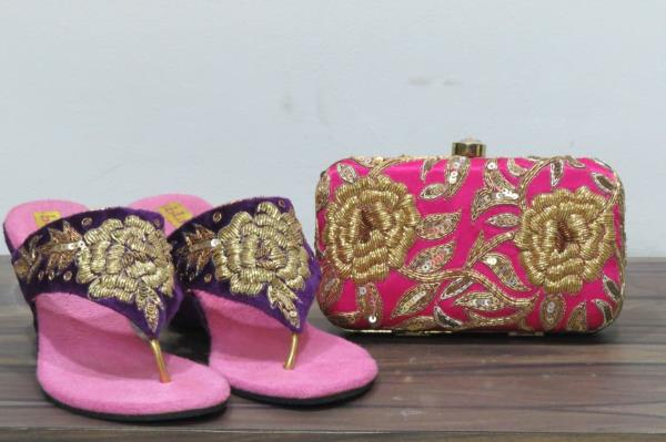 Perfectly matched box clutch and footwear made to perfection! Floral inspired Zardosi footwear and box clutch!