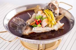 Steamed Marble Goby with Preserved Vegetables on Hot Plate 招牌铁板酸菜蒸笋壳