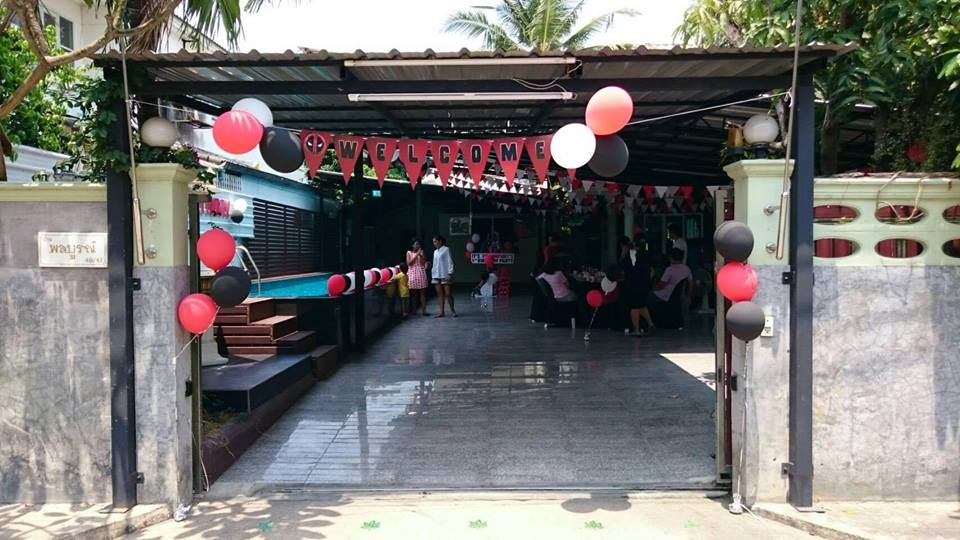 Customized Deadpool Birthday Party including photo corner, balloons, entrance, cake table, birthday cake and more