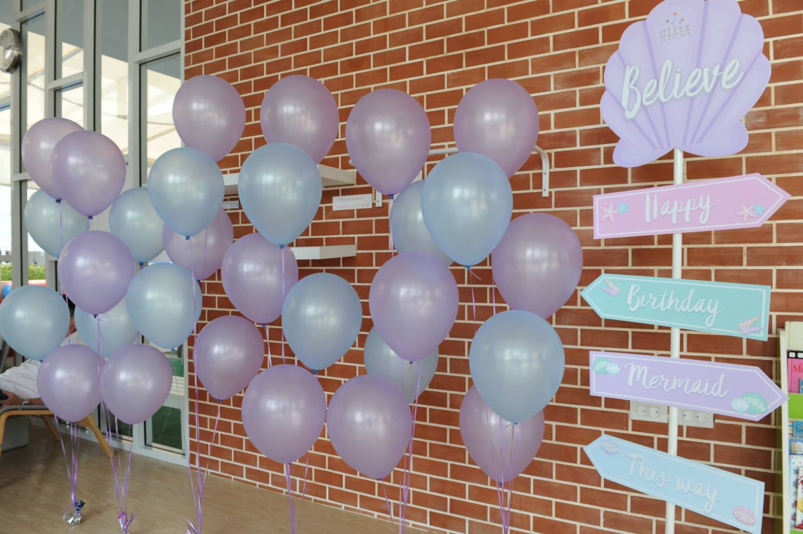 Cute Believe and her mermaid birthday party - theme idea for your kids next birthday including ribbon backdrop, kids table setting, dessert table, goodie bags, pinata and more
