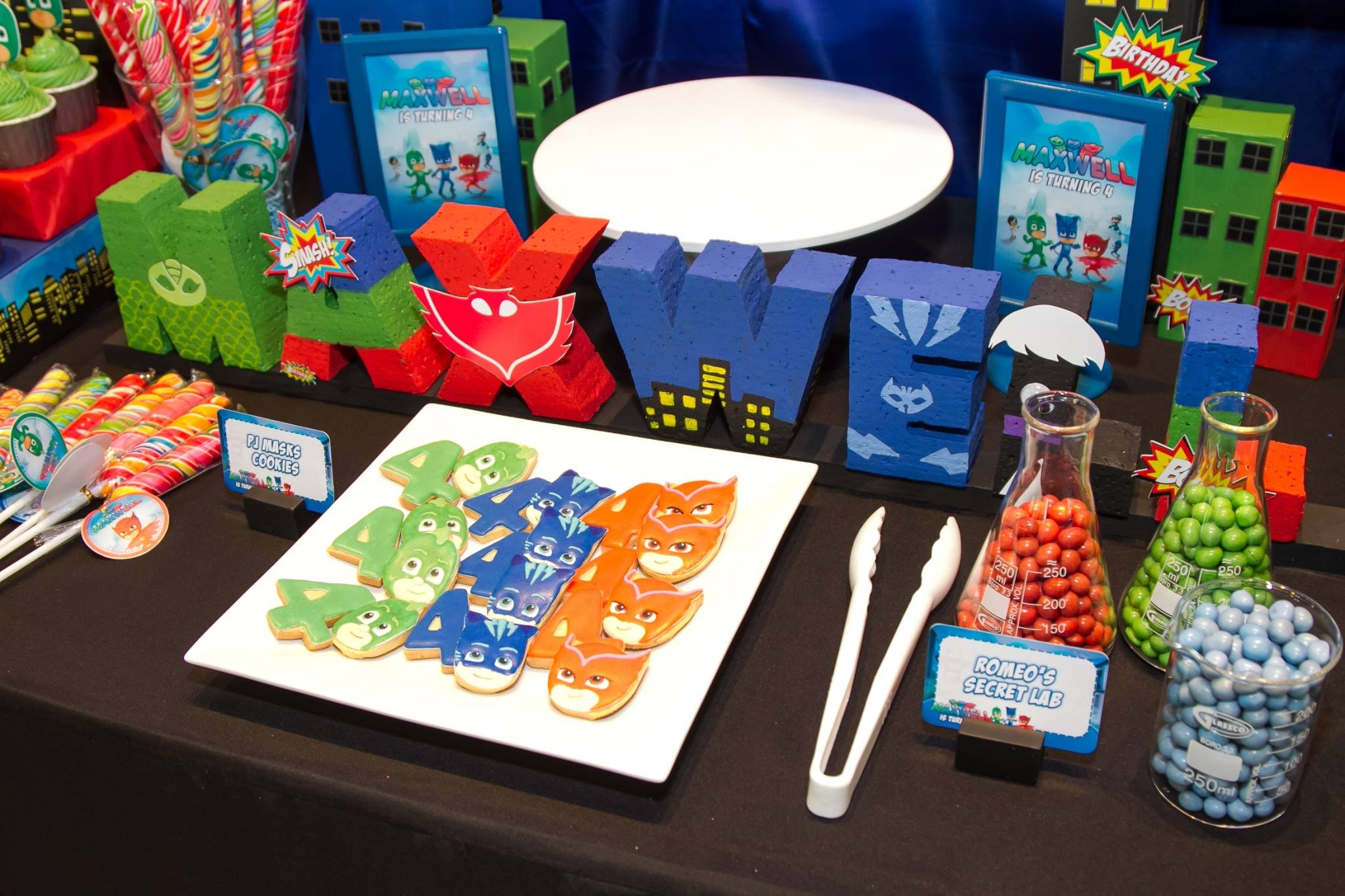 Maxwell's PJ Masks birthday party with cute decorations, backdrop, cake table, kids table, PJ Masks cake and desserts, costumes