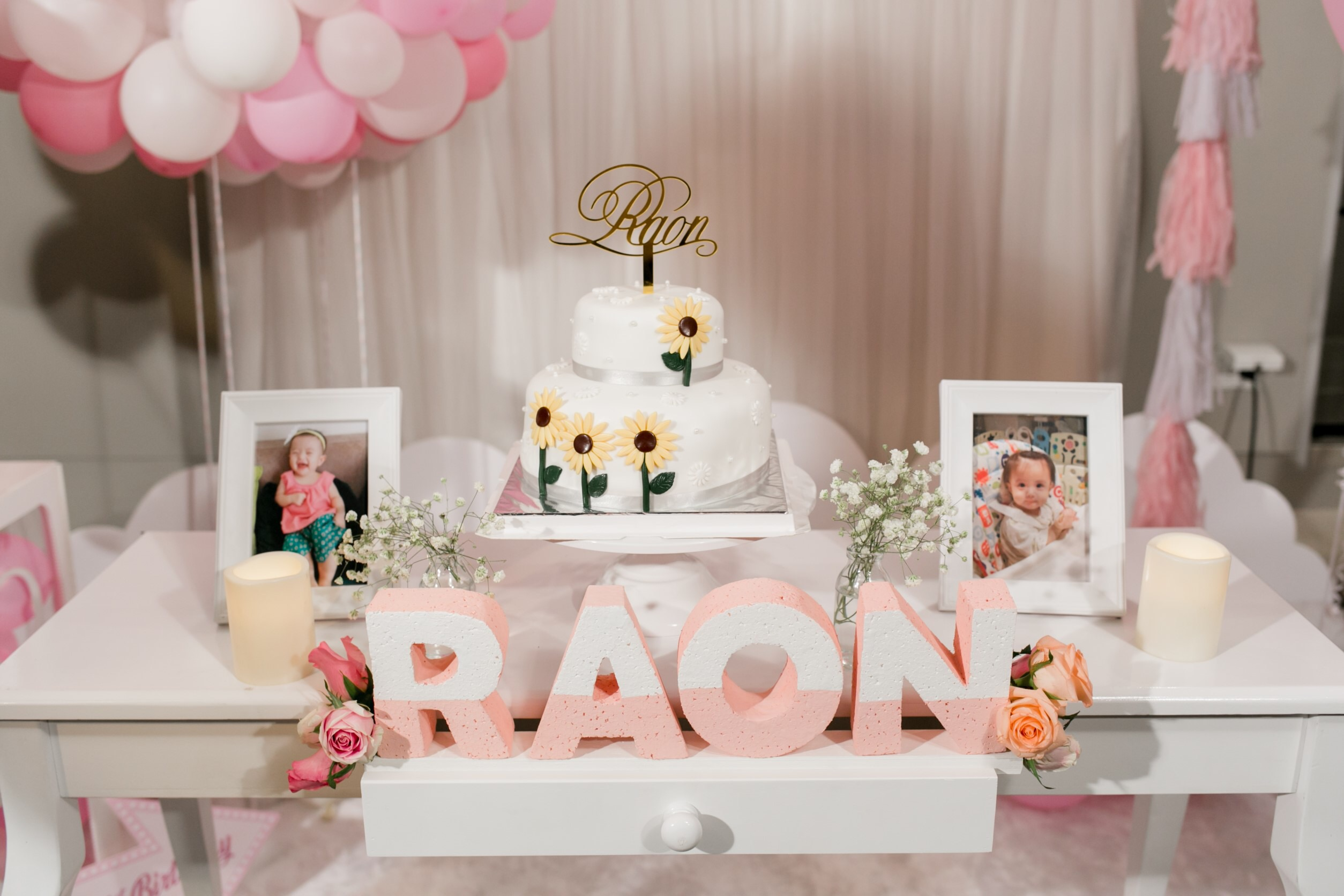 Cute pink birthday party decoration, backdrop, balloons, cake table, birthday cake and themed desserts