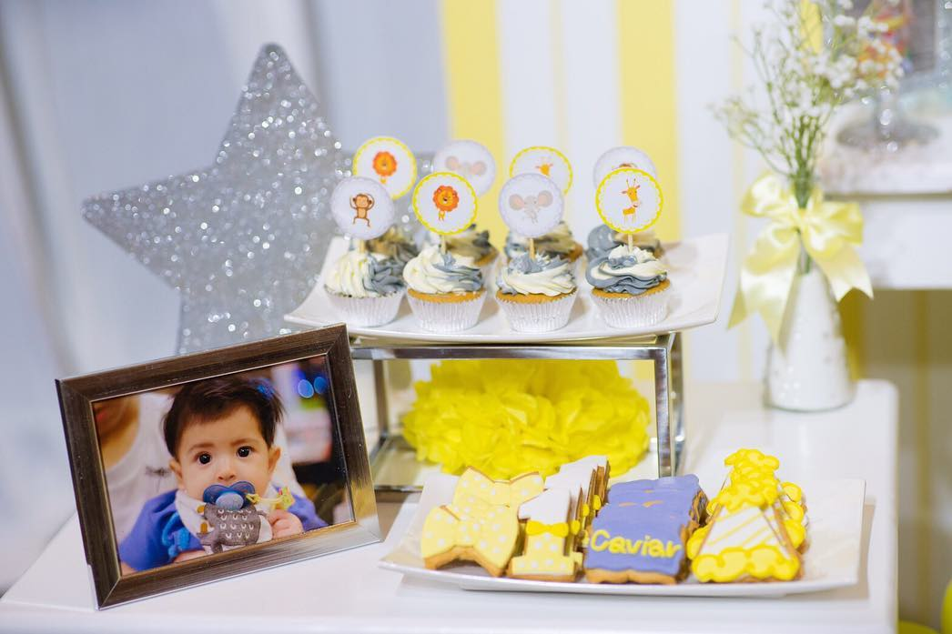 Birthday decoration in yellow theme party, adding animals, balloon arch, cake table, dessert table to make party amazing
