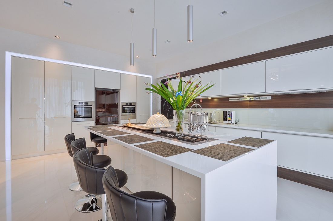 Spacious Modern Contemporary Kitchen Design Utilizing Gloss White Finishes Complemented By Timber Laminate Highlights