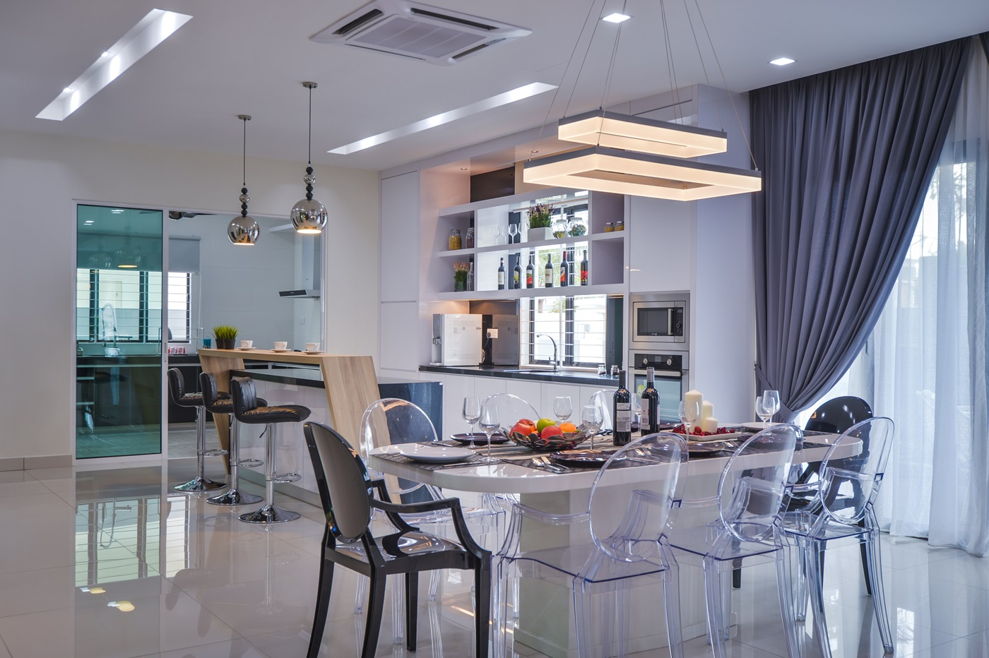 Living Area Draws Attention While The Grey Curtains Modern Lighting And Ghost Chairs Are Used To Create A Contemporary Look In This Malaysian