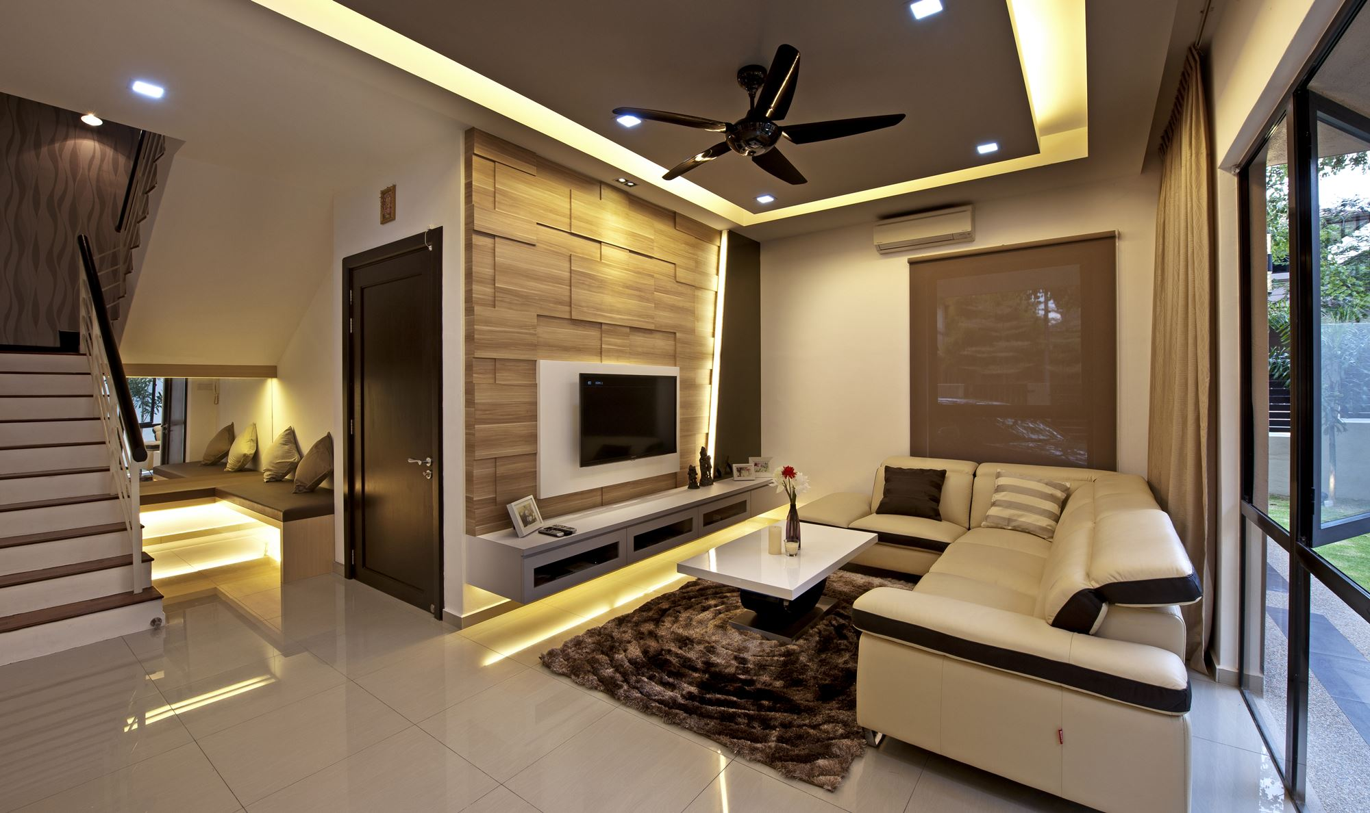 Bringing the resort home to aman sari by surface r for Modern living room malaysia
