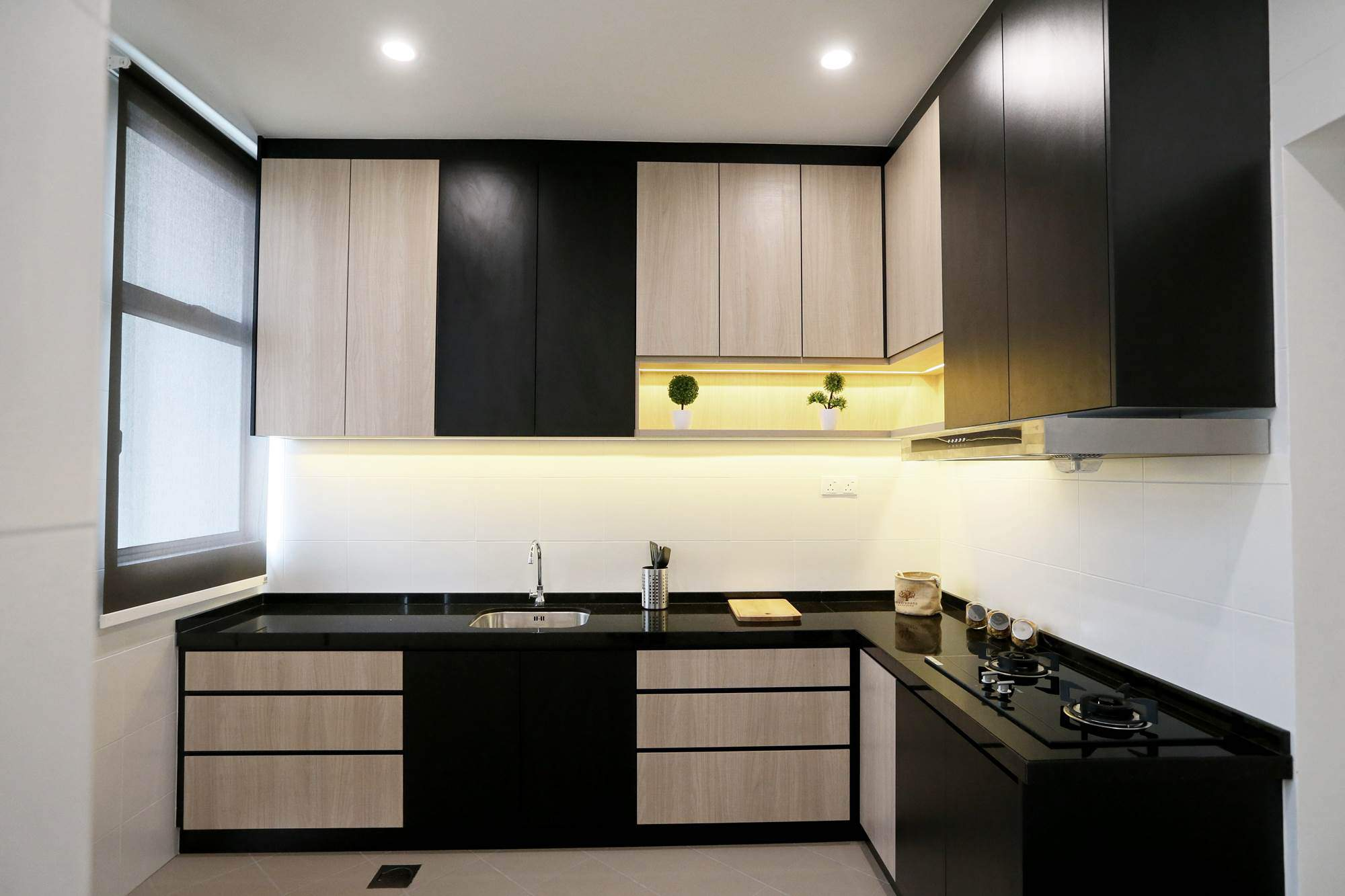 Modern Terrace House Kitchen Design Features Black And Light Timber  Finishes.