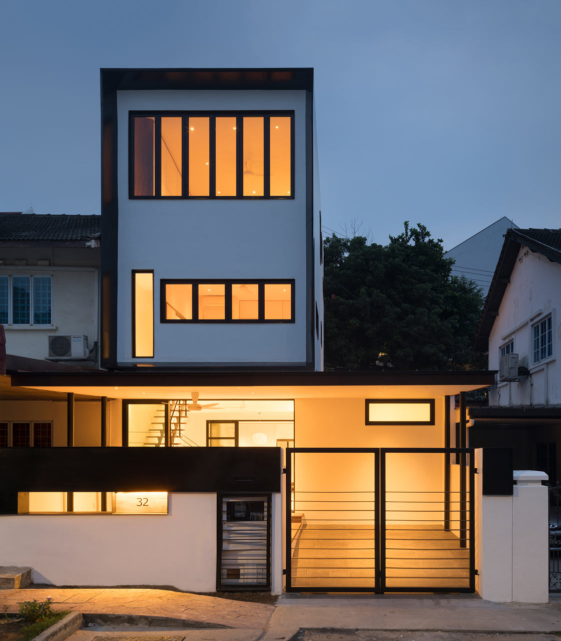 Rectangular front facade with incorporated modern windows gives this terrace house a more modern outlook