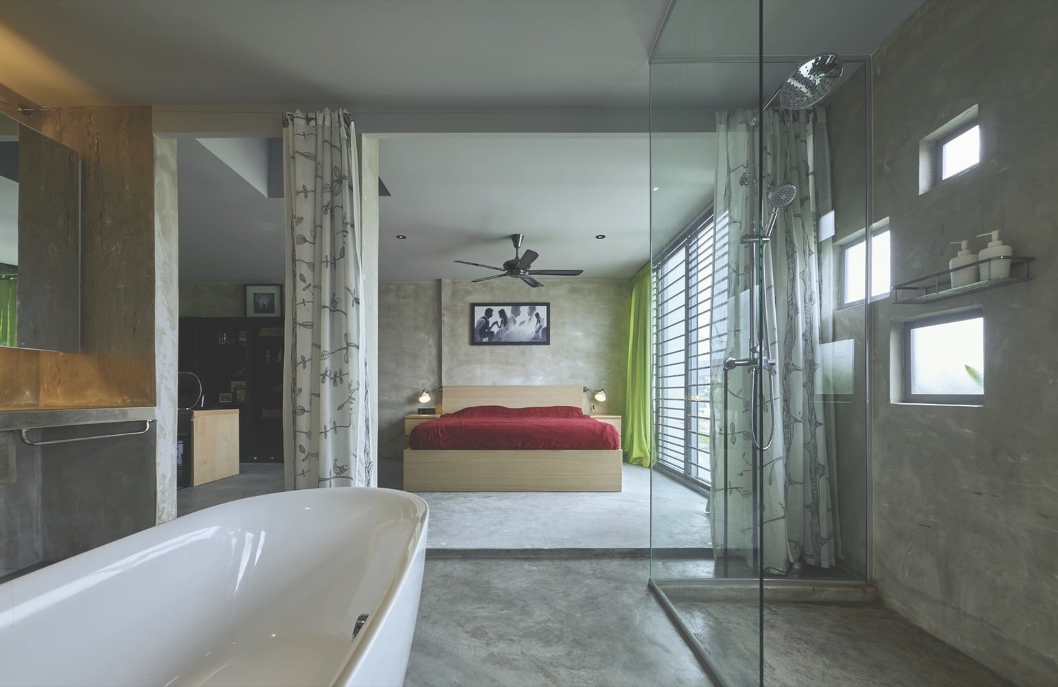 Bedroom and bathroom utilize sleek cement rendered finishing for a modern industrial look.