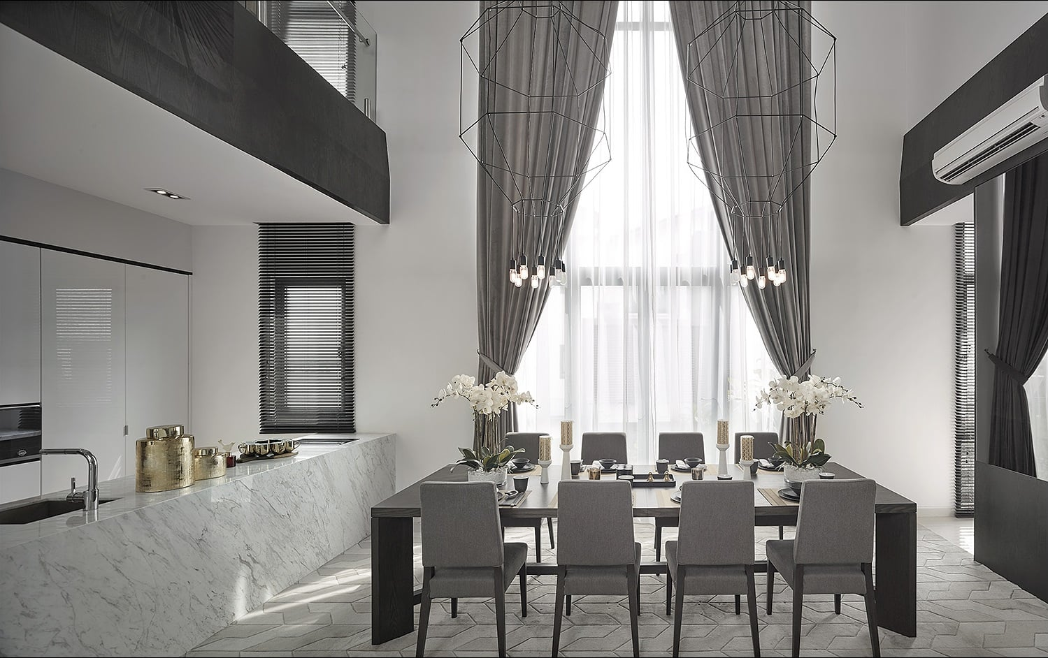 Vibia wireflow pendant lighting hangs over this classy double volume dining area.