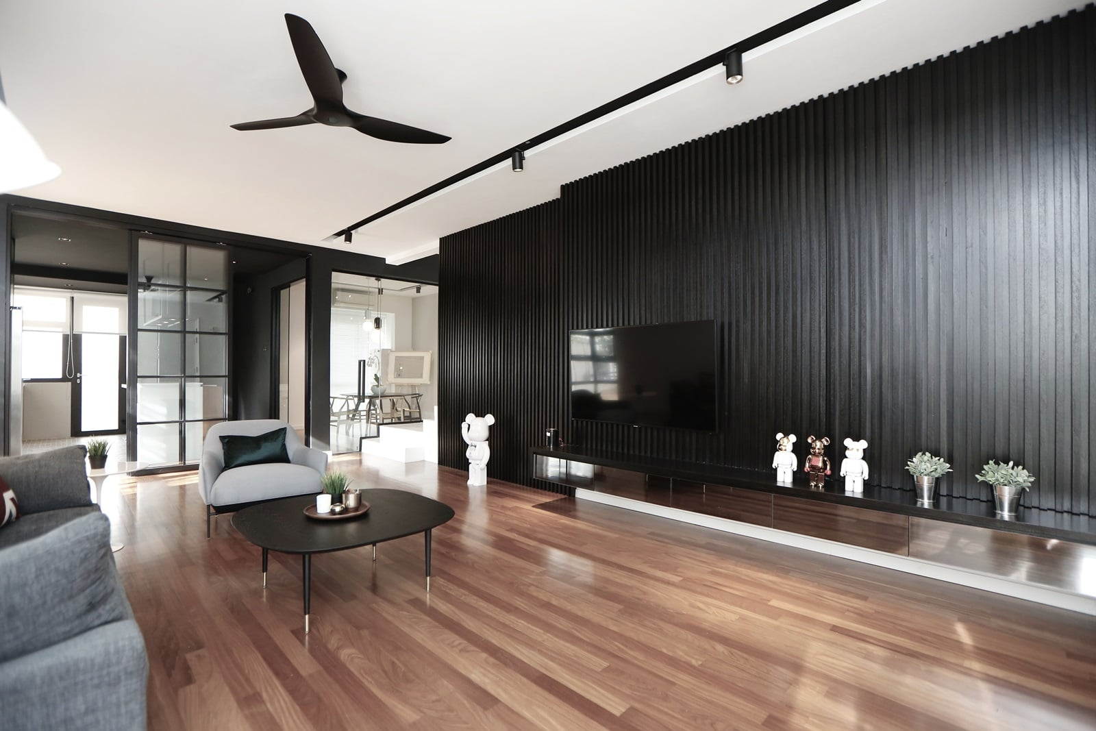 Contrasting elements of dark and light look stunning in the living area complemented beautifully by the timber flooring.
