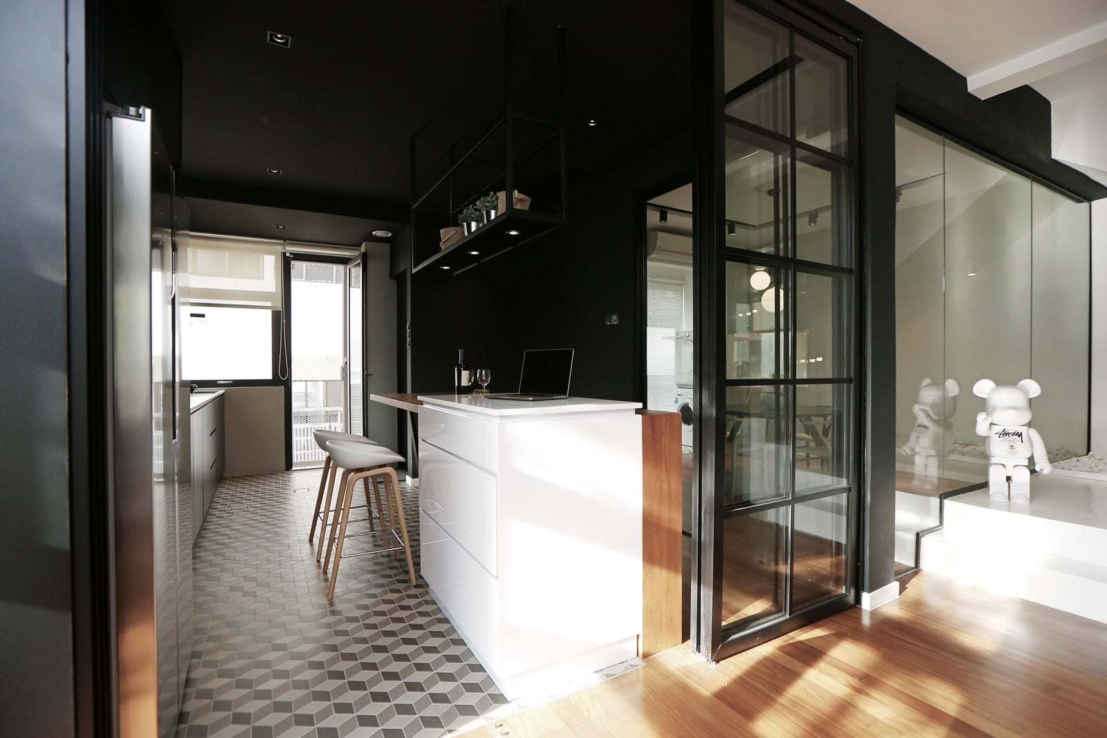 Sliding doors open to allow access to the kitchen.